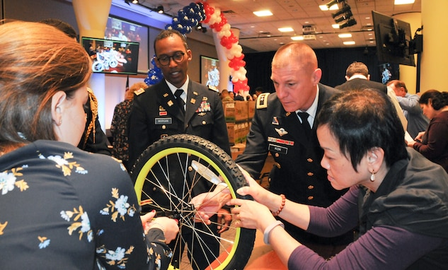 Army Reserve leader helps build bikes for military children