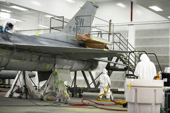 U.S. Airmen assigned to the 20th Equipment Maintenance Squadron corrosion control paint barn, work on an F-16CM Fighting Falcon at Shaw Air Force Base, S.C., Nov. 13, 2018.