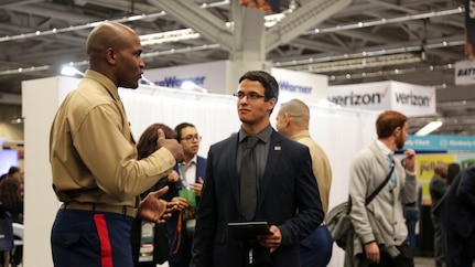 Alexander Arzon, electrcal engeginering studetn at Clemson University, speaks to Capt. Maurice Kitchens Jr. at the Society of Hispanic Professional Engineers (SHPE) 2018 National Convention in Cleveland, Nov. 9, 2018. Nearly 7,000 students, all of Hispanic heritage, attended the SHPE 2018 National Convention, which provided students an opportunity to network with the engineering community and show off their skills. (U.S. Marine Corps Photo by Cpl. Nelson Duenas)