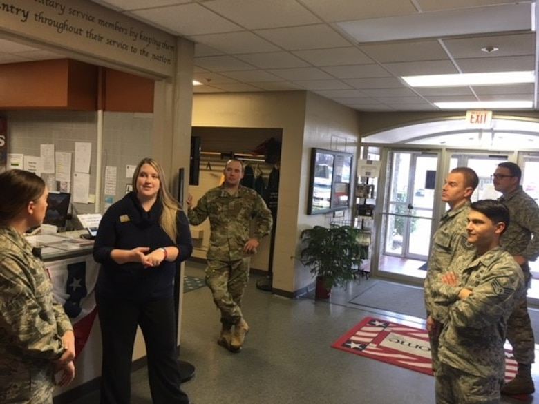 Whitney Armstrong, assistant manager at the Wright-Patterson AFB United Services Organization, greets and speaks with Airmen about upcoming holiday and other special events the USO will offer.