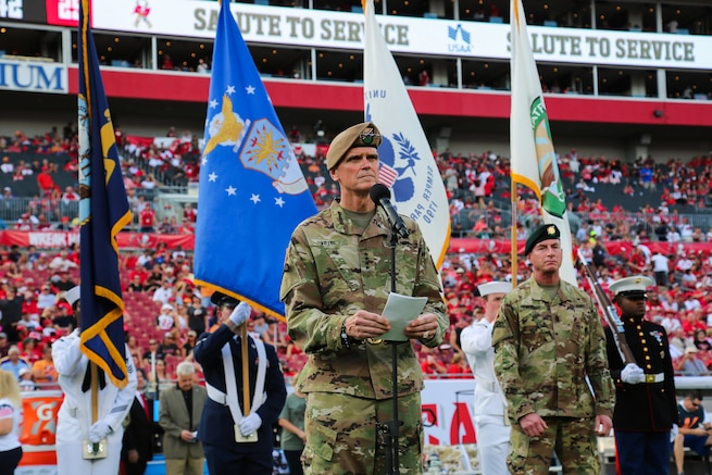 U.S. Army Gen. Joseph Votel, commander, U.S. Central Command, and Command Sgt. Maj. Bill Thetford, U.S. Central Command's senior enlisted leader await the arrival of approximately 130 future service members prior to an Oath of Enlistment ceremony at Raymond James Stadium, Nov. 11th, 2018. The enlistees were provided a unique opportunity to take the Oath of Enlistment in front of thousands of football fans, during halftime of the Tampa Bay Buccaneers home game versus the Washington Redskins. (U.S. Central Command Public Affairs photo by Tom Gagnier)