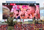 U.S. Army Gen. Joseph Votel, commander, U.S. Central Command, administers the Oath of Enlistment to approximately 130 future service members during a ceremony at Raymond James Stadium, Nov. 11th, 2018. The enlistees were provided a unique opportunity to take the Oath of Enlistment in front of thousands of football fans, during halftime of the Tampa Bay Buccaneers home game versus the Washington Redskins. (U.S. Central Command Public Affairs photo by Tom Gagnier)