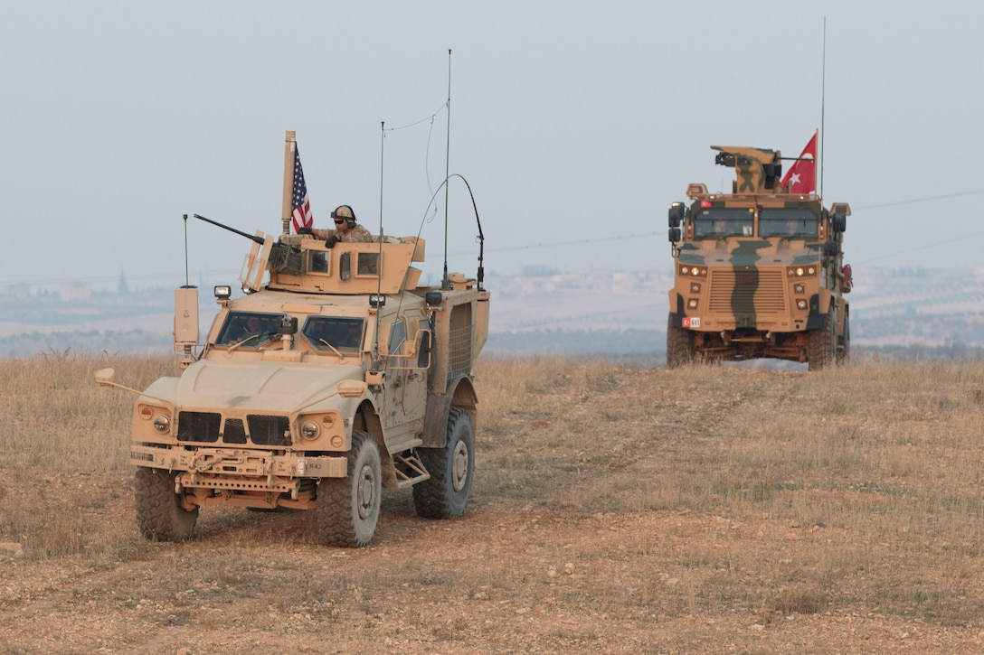 American and Turkish troops conduct a convoy during a joint patrol in Manbij, Syria.