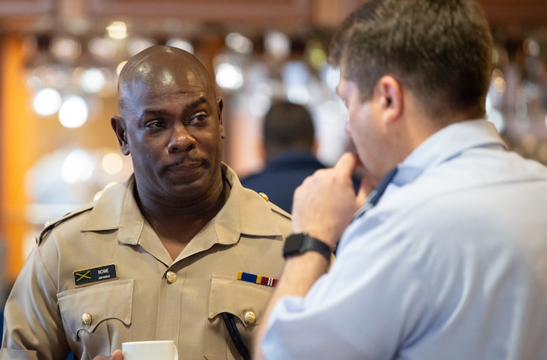 Lt. Col. Roderick Rowe, Jamaican Defense Force Air Wing commander, listens to a Chilean Air Force representative during the Central American and Caribbean Air Chief's conference at Davis-Monthan Air Force Base, Ariz., Nov. 6-8, 2018.