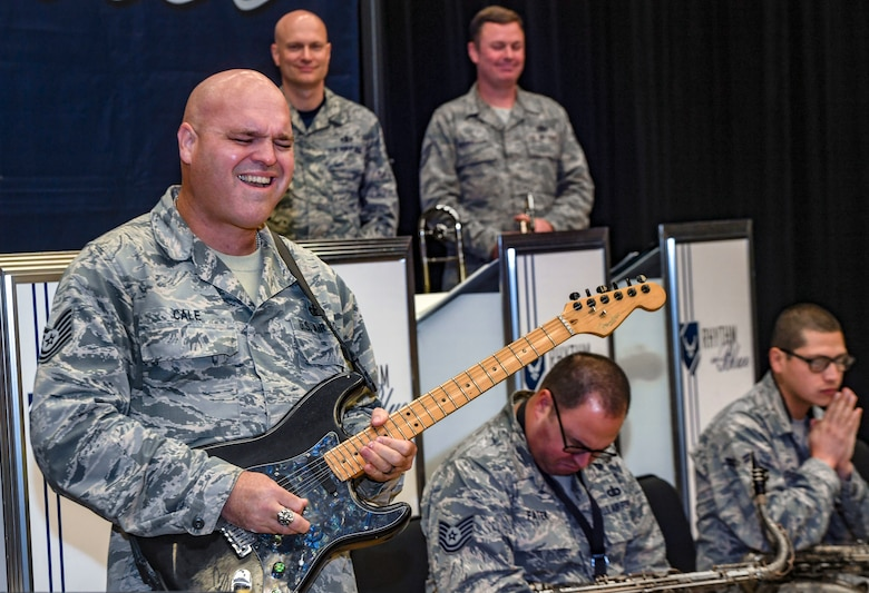 Tech. Sgt. Jason Cale, Rhythm in Blue guitar player, plays during a training session at Joint Base Langley-Eustis, Va., Oct. 26, 2018. The Air Force's bands consist of one premier band, eleven active duty bands and five Air National Guard bands that feature professional enlisted and commissioned musicians. Their bands honor, inspire and connect reaching over six million listeners at over five thousand live and televised performances each year. (U.S. Air Force photo by Tech. Sgt. Nick Wilson)