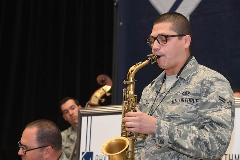 Airman 1st Class Richard Garcia, Rhythm in Blue alto saxophone player, plays during a training session at Joint Base Langley-Eustis, Va., Oct. 26, 2018. Air Force bands serve as a dynamic element to recruit future Airmen to serve in the United States Air Force. In partnership with Air Force Recruiting Service, they perform for events that generate interest and enthusiasm for military service. (U.S. Air Force photo by Tech. Sgt. Nick Wilson)