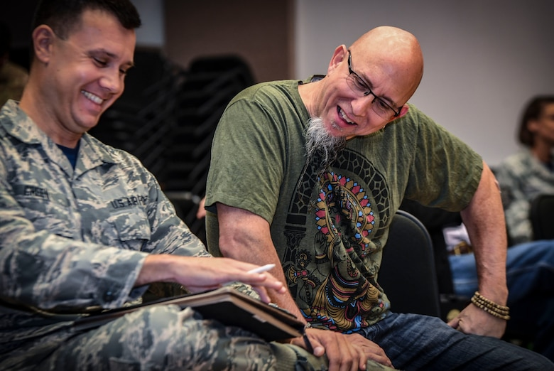 Grammy Award-winning saxophonist Jeff Coffin laughs with Senior Airman Bradley Greene, Rhythm in Blue music composer, during a visit to the Rhythm in Blue Jazz band at Joint Base Langley-Eustis, Va., Oct. 26, 2018. The Rhythm in Blue jazz band is one of seven ensembles from Air Combat Command's Heritage of America Band. The band uses their music to tell the Air Force story throughout the Eastern United States, performing for diverse audiences from Maine to South Carolina. (U.S. Air Force photo by Tech. Sgt. Nick Wilson)