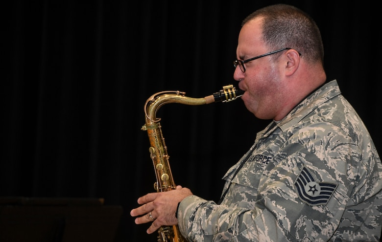 Tech. Sgt. David Fatek, Rhythm in Blue tenor saxophone player, plays during a training session at Joint Base Langley-Eustis, Va., Oct. 26, 2018. The Air Force has 17 bands that each operate within their own geographic area of responsibility. They have a mission to represent America's Airmen to a global audience, and to tell the Air Force story by performing and engaging diverse audiences, political figures and decision makers around the globe. (U.S. Air Force photo by Tech. Sgt. Nick Wilson)