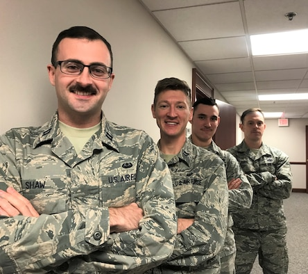 Left to right, Capt. Tim Shaw, Capt. John Lipscomb, Staff Sgt. Dakota Herndon and Tech Sgt. Matt Paris and from the 88th Air Base Wing Judge Advocates office, are growing mustaches in support of Mustache Movember. Movember is an annual event of growing mustaches during the month of November to bring awareness to men's health issues such as prostate, testicular cancer and mental health.  (U.S. Air Force photo by Stacey Geiger)