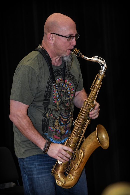 Grammy Award-winning musician Jeff Coffin plays the tenor saxophone during a training session at Joint Base Langley-Eustis, Virginia, Oct. 26, 2018. Coffin discussed his personal experiences and emphasized the impact music can make on the world when it is used as a tool to bridge cultural gaps. (U.S. Air Force photo by Tech. Sgt. Nick Wilson)