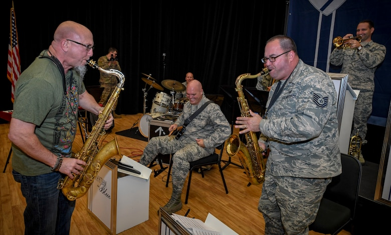 Grammy Award-winning saxophonist Jeff Coffin plays with U.S. Air Force Tech. Sgt. David Fatek, Rhythm in Blue tenor saxophone player, during a training session at Joint Base Langley-Eustis, Virginia, Oct. 26, 2018. The Rhythm in Blue jazz band has a mission to communicate U.S. Air Force and Department of Defense messages by making lasting connections with their audiences. (U.S. Air Force photo by Tech. Sgt. Nick Wilson)
