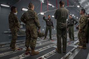 U.S. Air Force Chief Mast Sgt. Jason Hall, 97th Operations Group superintendent, showcases the KC-46 Pegasus Fuselage Trainer to the Air Force Personnel Center Career Enlisted Aviators assignment branch,