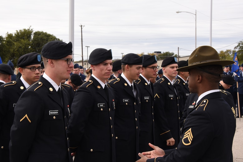 U.S. Army Staff Sgt. Brandon Lee, 344th Military Intelligence Battalion instructor, speaks to students before the Veterans Day Parade in San Angelo, Texas, Nov. 10, 2018. Members of the 344th MI BN joined the other organizations of Goodfellow to march and show support for those who have served and still serve. (U.S. Air Force photo by Airman 1st Class Zachary Chapman/Released)