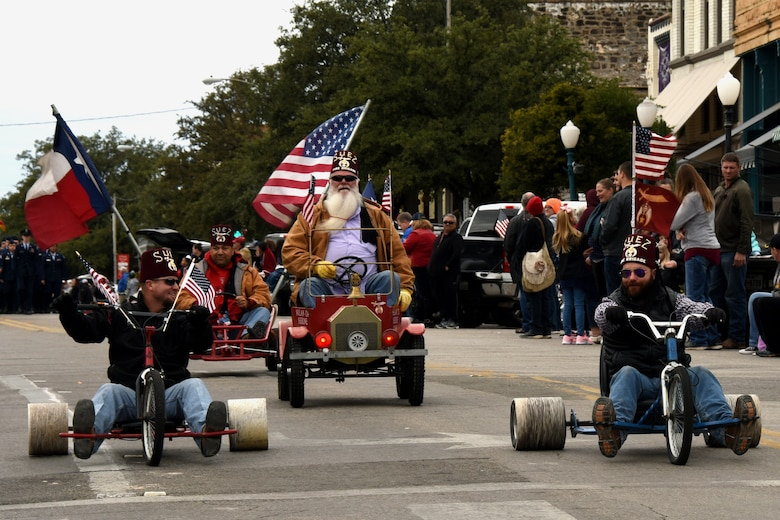 Members from the Suez Shriners, Concho Shrine Club, ride in the Veterans Day Parade in San Angelo, Texas, Nov. 10, 2018. Groups from San Angelo joined service members to show their support during the Veterans Day Parade. (U.S. Air Force photo by Airman 1st Class Zachary Chapman/Released)