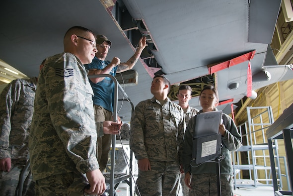 Staff Sgt. Caleb Gobbles, a 302nd Maintenance Squadron aircraft structures technician, demonstrates the use of a borescope to cadets from the U.S. Air Force Academy, Colorado, to detect metal corrosion beneath the tail of a C-130 Hercules aircraft Oct. 23, 2018, at Peterson Air Force Base, Colorado.