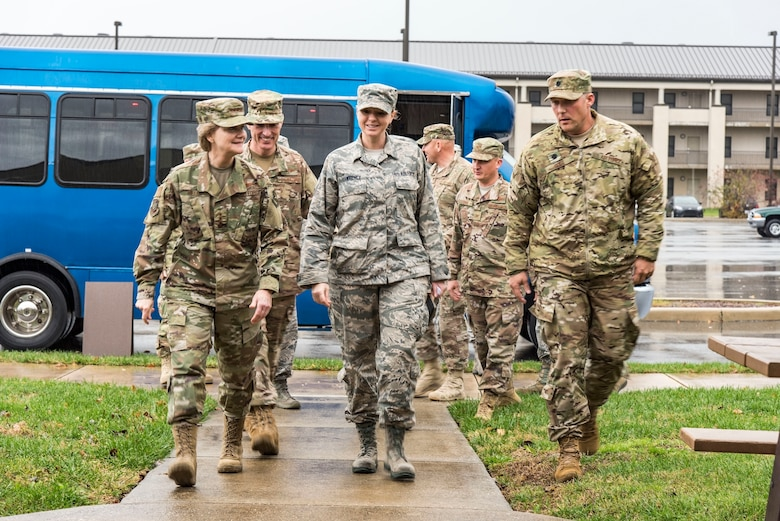 Left to right, Gen. Maryanne Miller, Air Mobility Command commander; Master Sgt. Amber Lawrence, 436th Civil Engineer Squadron unaccompanied housing supervisor; and Lt. Col. Travis Guidt, 436th CES commander, walk up to dormitory 401 for a briefing on its history Nov. 6, 2018, at Dover Air Force Base, Del. Lawrence briefed Miller that this particular dorm was built in 1976 and received a minor renovation in 2004. (U.S. Air Force photo by Roland Balik)