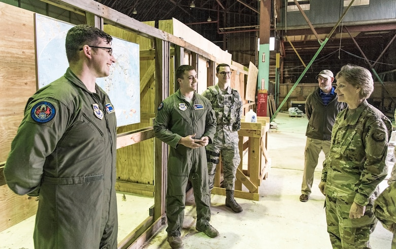 Gen. Maryanne Miller, right, Air Mobility Command commander, speaks with 436th Security Force Squadron Ravens, Staff Sgt. Tyler Smith, Senior Airman Nicholas Christopher, and Staff Sgt. Kirk Salvage, left to center respectively, Nov. 6, 2018, at Dover Air Force Base, Del. The three briefed Miller about the construction and use of the shoot house in an unused building. The shoot house on base eliminates the need to schedule training times at local off-base facilities. (U.S. Air Force photo by Roland Balik)