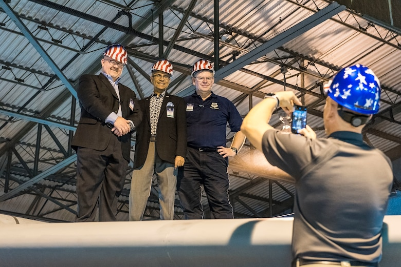 Air Mobility Command civic leaders pose for a photo on top of a C-5M Super Galaxy T-tail while undergoing maintenance in the 436th Maintenance Squadron C-5 Isochronal Inspection Dock Nov. 7, 2018, at Dover Air Force Base, Del. The vantage point gave the civic leaders a birds-eye view of the maintenance being performed more than 65 feet below. (U.S. Air Force photo by Roland Balik)