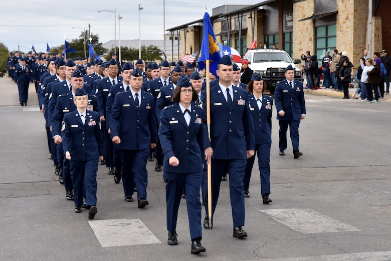 Airmen from the 17th Medical Group march in the Veterans Day Parade in San Angelo, Texas, Nov. 10, 2018. The parade featured veterans, active duty members and other organizations. (U.S. Air Force photo by 2nd Lt. Matthew Stott/Released)