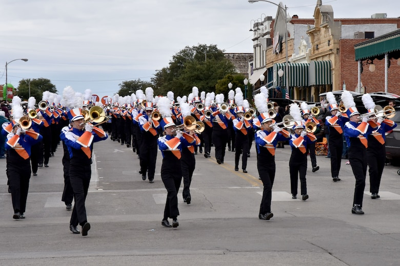 Members of the San Angelo Central High School Mighty Bobcat Band march and play their instruments in the Veterans Day Parade in San Angelo, Texas, Nov. 10, 2018. They were one of several bands that played during the parade. (U.S. Air Force photo by 2nd Lt. Matthew Stott/Released)