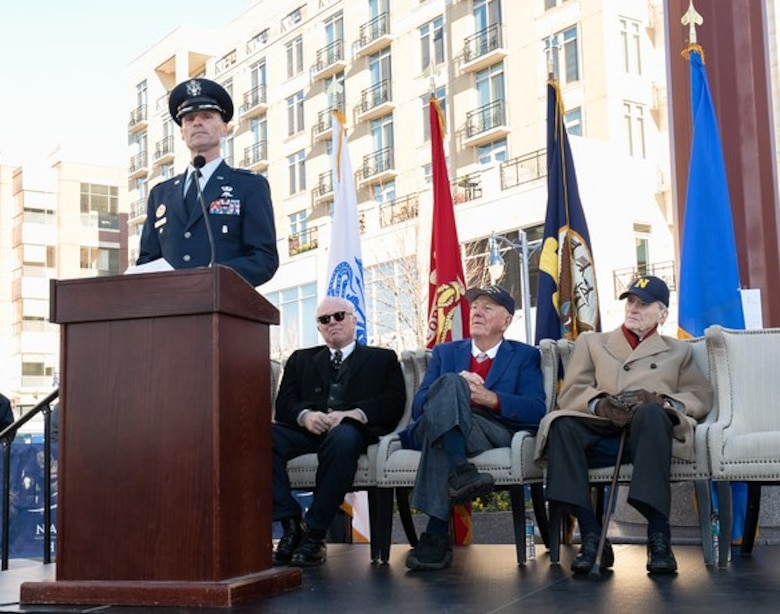 Featured speakers on the dais for Veterans Day event.