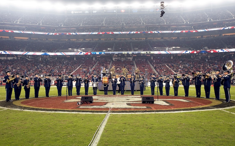 The U.S. Air Force Band of the Golden West from Travis Air Force Base, California, perform during halftime of the San Francisco Forty-Niners and New York Giants Monday Night Football game at Levi's Stadium in Santa Clara, California, Nov. 12, 2018. The band performed in honor of Veterans Day and to support the National Football League's Salute to Service Campaign. (U.S. Air Force photo by Louis Briscese)