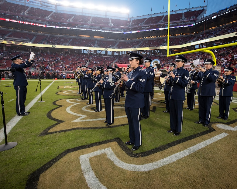The U.S. Air Force Band of the Golden West from Travis Air Force Base, California, perform during pregame of the San Francisco Forty-Niners and New York Giants Monday Night Football game at Levi's Stadium in Santa Clara, California, Nov. 12, 2018. The band performed in honor of Veterans Day and to support the National Football League's Salute to Service Campaign. (U.S. Air Force photo by Louis Briscese)