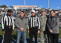 U.S. Air Force Col. Sean Tyler, 633rd Air Base Wing commander, poses with retired U.S. Navy Petty Officer 2nd Class Brian Graves and members from the Old Dominion University Monarchs football program before a football game at ODU in Norfolk, Virginia, Nov. 10, 2018.