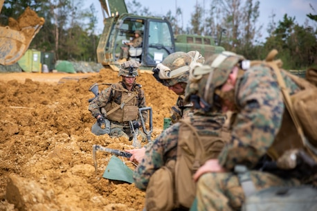 Marine combat engineers fill sandbags for defensive positions during a Marine Corps Combat Readiness Evaluation (MCCRE) at Camp Hansen, Okinawa, Japan, Nov. 6, 2018.