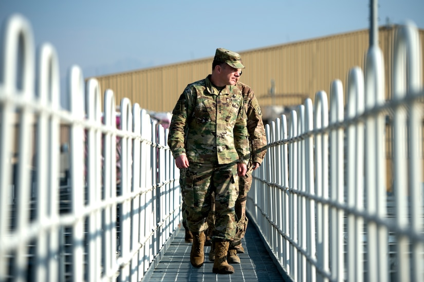 U.S. Army Gen. Stephen Lyons, commander of U.S. Transportation Command, looks out at the cargo yard during a visit to Bagram Airfield, Afghanistan Nov. 11, 2018.
