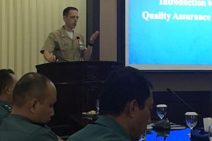 SURABAYA, Indonesia (Nov. 14, 2018) Cmdr. Randolph Reed, Submarine Group 7 Deputy Chief of Staff for Plans, Exercises & Engagement, gives a brief to members of the Indonesian Navy during U.S.-Indonesia staff talks in Surabaya, Indonesia. During the staff talks, headed by Rear Adm. Jimmy Pitts, Commander, Submarine Group 7,  personnel from both nations will exchange best practices on submarine force tactics and crisis response.