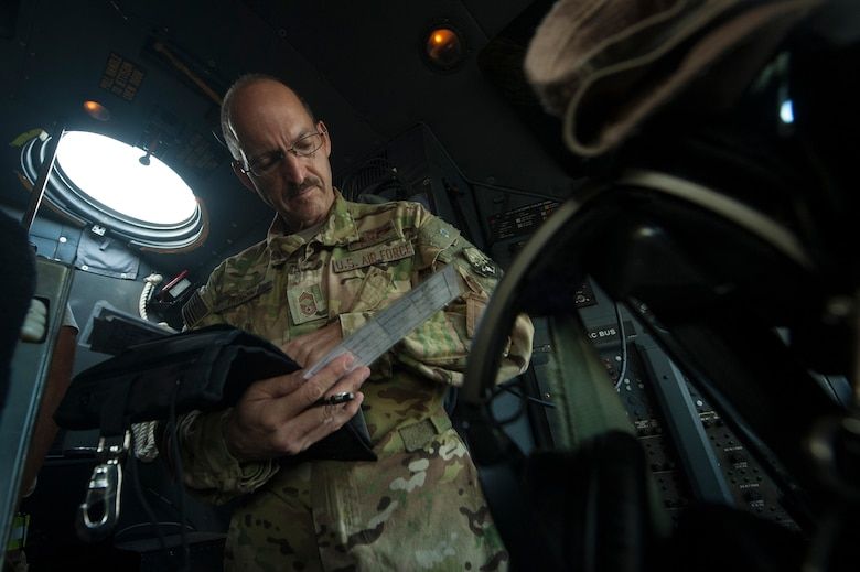 U.S. Air Force Reserve Chief Master Sgt. Kenneth Kunkel, 746th Expeditionary Airlift Squadron C-130 Hercules flight engineer, processes paperwork for a C-130 Hercules pre-flight inspection Nov. 13, 2018, at Al Udeid Air Base, Qatar. Kunkel reached 10,000 flying hours Oct. 6, 2018, a number considered prestigious amongst military aviators. (U.S. Air Force photo by Tech. Sgt. Christopher Hubenthal)