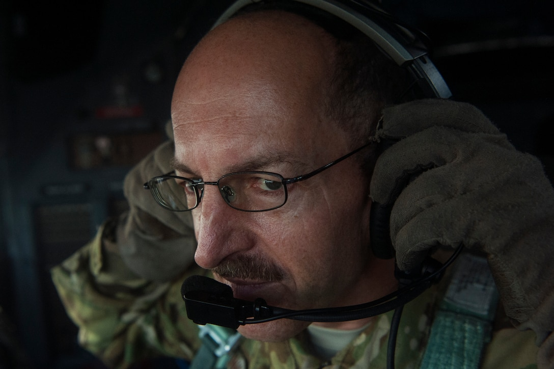 U.S. Air Force Chief Master Sgt. Kenneth Kunkel, 746th Expeditionary Airlift Squadron C-130 Hercules flight engineer, checks his headset during a C-130 Hercules pre-flight inspection Nov. 13, 2018, at Al Udeid Air Base, Qatar. Kunkel reached 10,000 flying hours Oct. 6, 2018, a number considered prestigious amongst military aviators. (U.S. Air Force photo by Tech. Sgt. Christopher Hubenthal)