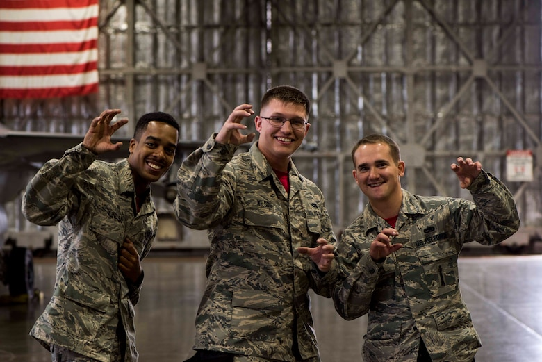 U.S. Air Force Senior Airman Travonne Lindsay, left, and Airman 1st Class Cody Wilson, center, both weapons load crew members, and Staff Sgt. Branden Goodrich, a load crew team chief, all with the 13th Aircraft Maintenance Unit, pose for a photo during the third quarter load competition at Misawa Air Base, Japan, Nov. 9, 2018. During the competition, Airmen raced against the clock to see which team could efficiently and accurately load munitions onto an F-16 Fighting Falcon. (U.S. Air Force photo by Airman 1st Class Collette Brooks)