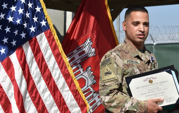 Staff Sgt. Vincent Fiorillo dons his Meritorious Service Medal and NATO medal as he ends a successful tour in Afghanistan supporting USACE in its rebuilding efforts in theater.