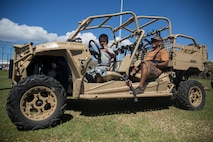 Tinian residents sit inside a military vehicle after a ceremony marking the end of the 31st Marine Expeditionary Unit's mission as part of the U.S. Defense Support of Civil Authorities relief efforts on Tinian, Commonwealth of the Northern Mariana Islands, Nov. 14, 2018. Marines and Sailors with the 31st MEU and Combat Logistics Battalion 31 assisted the U.S. Federal Emergency Management Agency and local and civil authorities on Tinian to deliver aid to Tinians affected by Super Typhoon Yutu, which struck here Oct. 25 as the second strongest storm to ever hit U.S. soil. Marines and Sailors with the 31st MEU and CLB-31 arrived on Tinian Oct. 29-31 to lead relief efforts on Tinian in response to Yutu as part of Task Force-West. TF-W is leading the Department of Defense's efforts to assist CNMI's local and civil authorities provide critical assistance for citizens devastated by Yutu. The 31st MEU, the Marine Corps' only continuously forward-deployed MEU, provides a flexible force ready to perform a wide-range of military operations across the Indo-Pacific region.