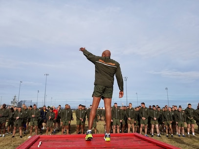 U.S. Marine Corps Sgt. Maj. Adam J. Moore, sergeant major of Headquarters and Service Battalion, U.S. Marine Corps Forces Command, leads Marines and Sailors during warm up exercises as part of the MARFORCOM 243rd Marine Corps birthday run Nov. 8, 2018, at Naval Station Norfolk, Norfolk, Virginia. The run was held in celebration of the 243rd Marine Corps birthday and to commemorate the 100 year anniversary of the end of World War I.  (U.S. Marine Corps photo by Sgt. Jessika Braden/Released)