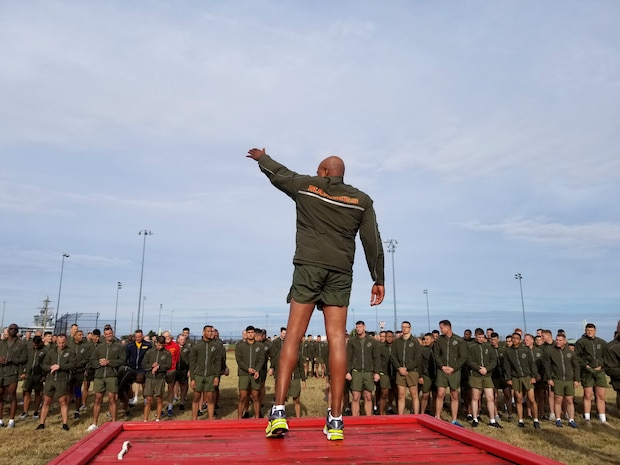 Sgt. Maj. Adam J. Moore, sergeant major of Headquarters and Service Battalion, U.S. Marine Corps Forces Command, leads Marines and Sailors during warm up exercises as part of the MARFORCOM 243rd Marine Corps birthday run Nov. 8, 2018, at Naval Station Norfolk, Norfolk, Virginia. The run was held in celebration of the 243rd Marine Corps birthday and to commemorate the 100 year anniversary of the end of World War I.  (U.S. Marine Corps photo by Sgt. Jessika Braden/Released)