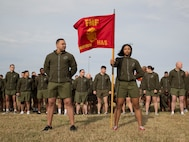U.S. Marines and Sailors with U.S. Marine Corps Forces Command stand in formation prior to the commencement of the MARFORCOM 243rd Marine Corps birthday run Nov. 8, 2018, at Naval Station Norfolk, Norfolk, Virginia. The run was held in celebration of the 243rd Marine Corps birthday and to commemorate the 100 year anniversary of the end of World War I.  (U.S. Marine Corps photo by Sgt. Jessika Braden/Released)