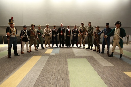 U.S. Marines with U.S. Marine Corps Forces Command participate in a uniform pageant during the 243rd Marine Corps birthday ball Nov. 3, 2018 at the Virginia Beach Convention Center, Virginia Beach, Virginia. Each year Marines commemorate the Marine Corps Birthday by reflecting on its rich traditions through the reading of General John A. Lejeune's Birthday Message and the cutting of the birthday cake. (U.S. Marine Corps photo by Lance Cpl. Garett Burns/Released)
