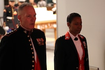 Lt. Gen. Mark A. Brilakis, left, commanding general of U.S. Marine Corps Forces Command, and Brig. Gen. Lorna Mahlock wait to be presented during the 243rd Marine Corps birthday ball Nov. 3, 2018 at the Virginia Beach Convention Center, Virginia Beach, Virginia. Each year Marines commemorate the Marine Corps Birthday by reflecting on its rich traditions through the reading of General John A. Lejeune's Birthday Message and the cutting of the birthday cake. (U.S. Marine Corps photo by Lance Cpl. Garett Burns/Released)