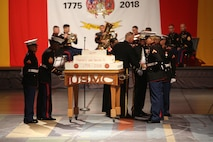 U.S. Marines participate in the Marine Corps birthday cake cutting ceremony during the 243rd Marine Corps birthday ball Nov. 3, 2018 at the Virginia Beach Convention Center, Virginia Beach, Virginia. Each year Marines commemorate the Marine Corps Birthday by reflecting on its rich traditions through the reading of General John A. Lejeune's Birthday Message and the cutting of the birthday cake. (U.S. Marine Corps photo by Lance Cpl. Garett Burns/Released)