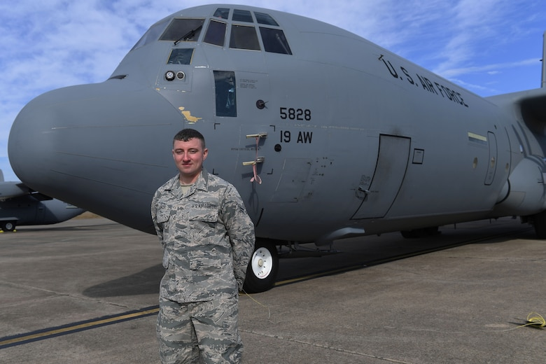 Man stands in front of plane.