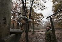 Sgt. 1st Class Mark Padifeld, 174th Infantry Brigade, 3rd Battalion, 314th Field Artillery Regiment fire support NCO observer and coach, run an obstacle course during the 2018 Service Member of the Year Competition on Joint Base McGuire-Dix-Lakehurst, New Jersey, Nov. 6, 2018. Competitors were awarded points based on their performance and time in each obstacle. (U.S. Air Force photo by Airman 1st Class Ariel Owings)