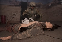 Sgt. 1st Class Andre Mangual, U.S. Army NCO Academy senior small group leader, performs tactical combat casualty care during the 2018 Service Member of the Year Competition on Joint Base McGuire-Dix-Lakehurst, New Jersey, Nov. 6, 2018. The competitors were evaluated at the Medical Simulation Training Center, where they had to apply life-saving first aid while under fire. (U.S. Air Force photo by Airman 1st Class Ariel Owings)