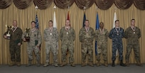 All competitors pose for a photo during the awards ceremony of the 2018 Service Member of the Year Competition on Joint Base McGuire-Dix-Lakehurst, New Jersey, Nov. 8, 2018. U.S. Marine Corps Staff Sgt. Lester Dickerson, Marine Light Attack Helicopter Squadron 773 aerial observer, won the NCO category and Airman 1st Class Jarrod Mohr, 87th Civil Engineer Squadron firefighter, won the junior enlisted category. (U.S. Air Force photo by Airman 1st Class Ariel Owings)