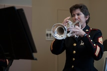 Staff Sgt. LeAnn Splitter, musician with the the Marine Forces Reserve Band, plays the trumpet before the start of a wheelchair basketball game at the Southeast Veteran's Hospital in New Orleans, Nov. 11, 2018