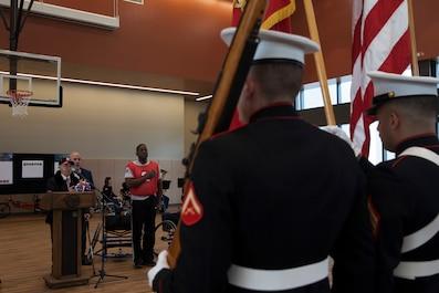 "Marine Veteran Faust ""Al"" Navazio recites the Pledge of Allegiance before a wheelchair basketball game at the Southeast Veteran's Hospital in New Orleans, Nov. 11, 2018."