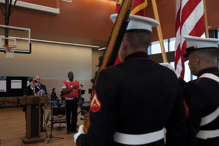 "Marine Veteran Faust ""Al"" Navazio recites the Pledge of Allegiance before a wheelchair basketball game at the Southeast Veteran's Hospital in New Orleans, Nov. 11, 2018."
