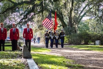 A Marine Forces Reserve color guard marches with the colors during a wreath laying ceremony for Gen. Robert H. Barrow, the 27th Commandant of the Marine Corps, at Grace Episcopal Church of West Feliciana in St. Francisville, La., Nov. 10, 2018.